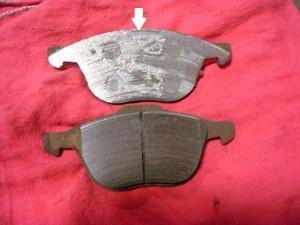 Metal on metal brake pad on top
