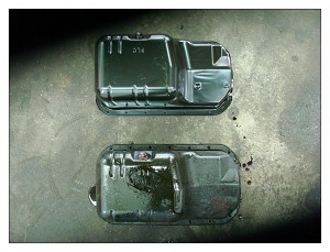 New oil pan shown on top, old oil pan on the bottom.