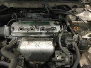 2001 Honda Accord Engine with spark plugs removed.